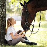 Image of child with horse.